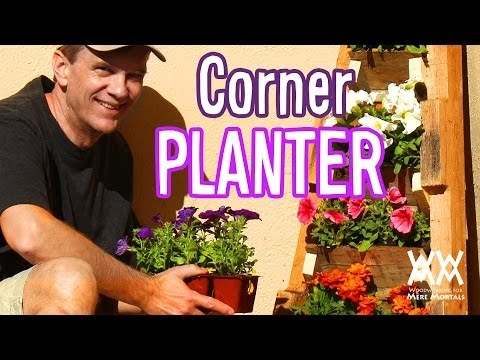 Vertical corner planter made from pallets. Limited tools project!