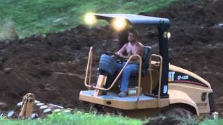 building a pond with 2 d6n dozers a 321clr ex and a cat compactor