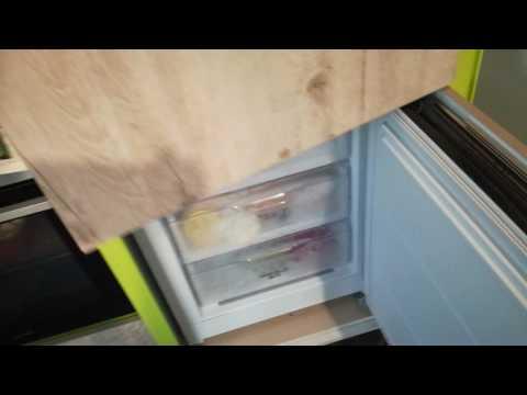 видео: Как встроить обычный холодильник в шкаф