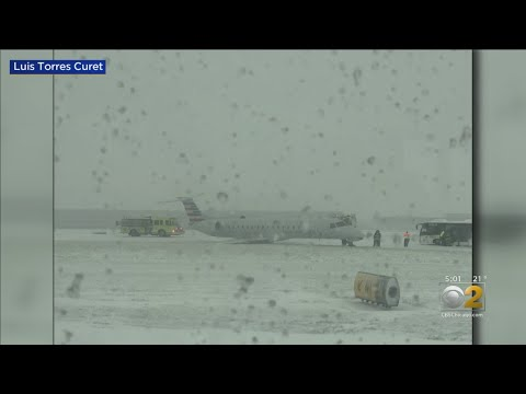 Plane Slides Off Runway at O'Hare