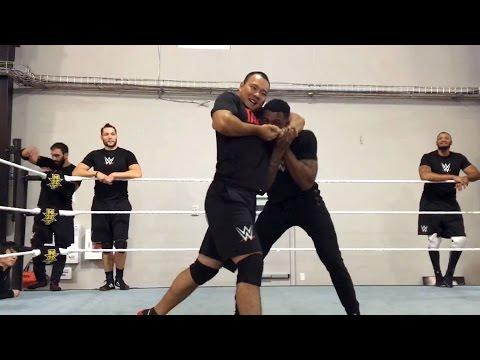 Tian Bing tightens a headlock on Kenneth Crawford