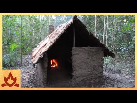 Dude builds a pretty impressive shelter in the wilderness with nothing but his bare hands