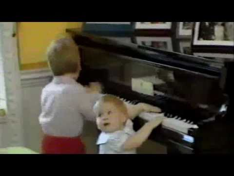 Prince William & Harry Playing The Piano  1985