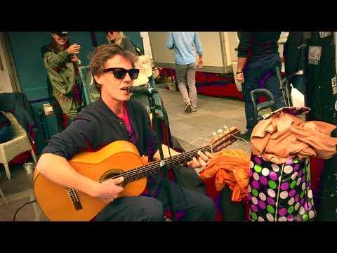 Street Performer Playing Brazilian Bossa Nova Guitar Music