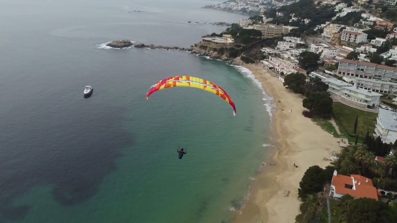 Flying over Almadrava beach, Roses, Spain. Hike and fly, paragliding