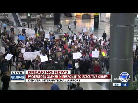 Protesters gather at DIA in response to refugee ban