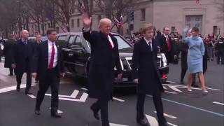 President Donald Trump and First Lady Obama walk inauguration parade route