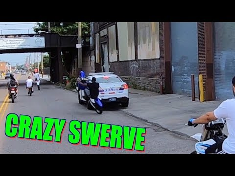 DIRT BIKE SWERVES COP CAR !!