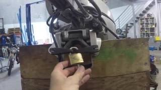 Locking an outboard to a boat