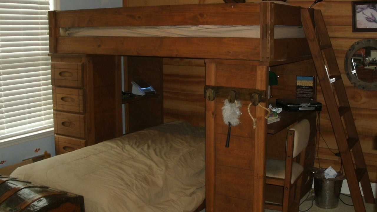 wooden bunk beds with desk and drawers