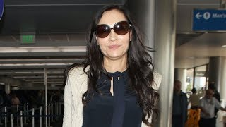 Famke Janssen DEFIES Age At 54 As She Travels Out Of L.A.!