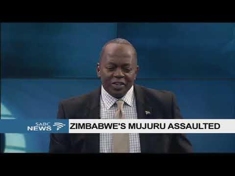 Zimbabwe's Mujuru attacked, assaulted at a campaign rally