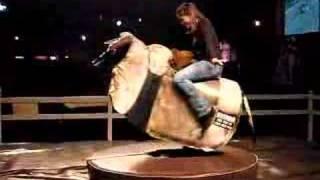 Linda riding mechanical bull at 8 Seconds Saloon