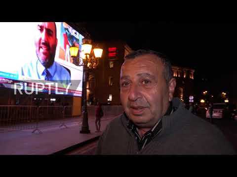 Locals react to screens in Baku and Yerevan streets showing news about Nagorno-Karabakh conflict
