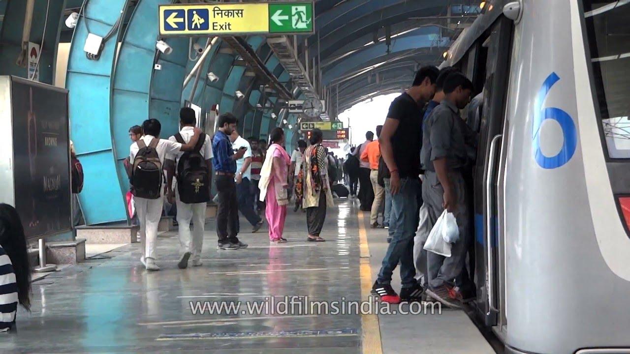 Crowded Delhi Metro platforms and trains