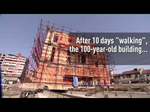 A historical building in Wuhan has been relocated 70 meters away by sliding it on rails