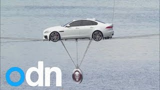 Car performs world's longest high-wire water crossing over Thames