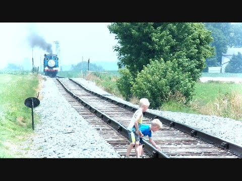 Children On Train Tracks While Train Is Approaching