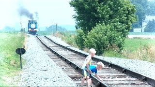 Children On Train Tracks While Train Is Approaching thumbnail
