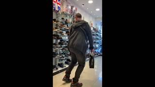 Jezz dancing in a shoe shop