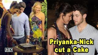 Priyanka-Nick cut a Cake with Priyanka's Vogue US Cover