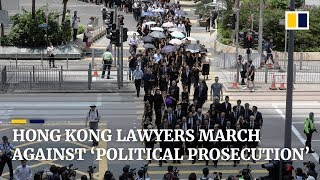 Hong Kong lawyers march against 'political prosecution'