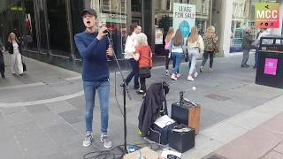 "Amazing young busker singing ""Hallelujah"""