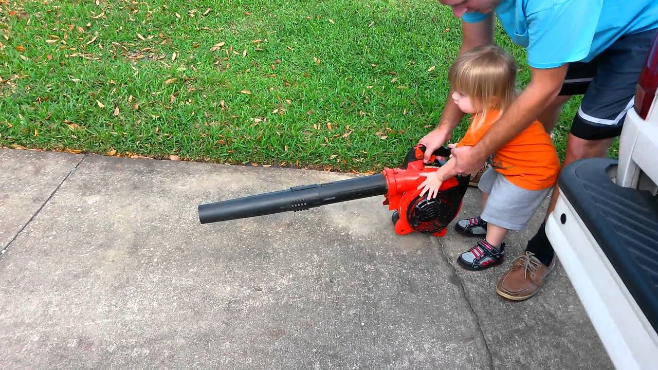 Toddler uses a leaf blower part 1