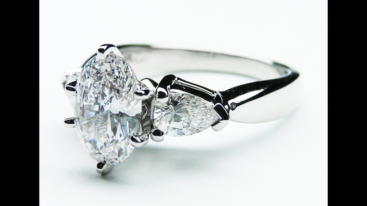 Oval Engagement Ring With Pear Side Stones