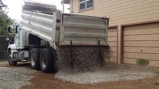 Gravel truck drops load PERFECTLY on new driveway