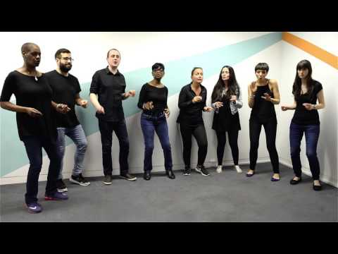 Sense of Sound Singers in rehearsal performing Sign O' The Times