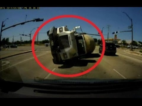 Cement Truck Flips Over, Crashes Into Minivan