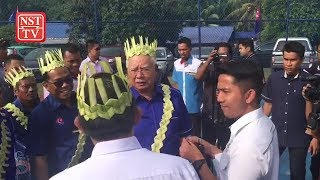 PM visits Orang Asli village during Pagoh trip