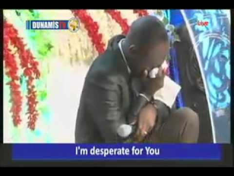 Dr Pst Paul Enenche weeps in Worship (with his daughter)