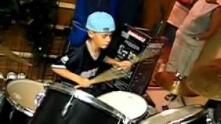 Justin Bieber playing the drums at age 9