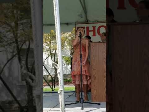 Isabella singing the National Anthem