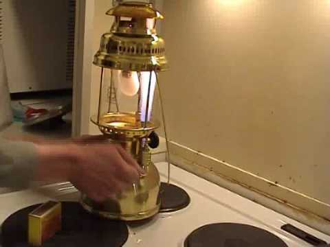 "Lighting a Petromax lantern using the ""Rapid"" preheater"
