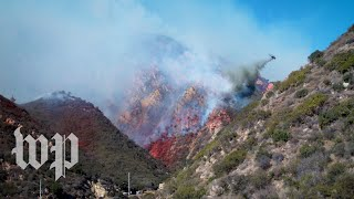 Planes equipped with water, flame retardant attempt to contain wildfire in Santa Monica Mountains