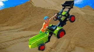Тиша, как ПАПА,катается на тракторе. Little TiSHA ride on a tractor bulldozer crashed into a tree.