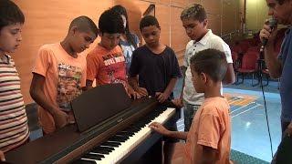 Baixar USP - Crianças descobrem a música na teoria e na prática