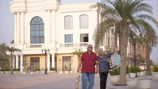 Elderly Indian couple walking and having fun in the streets of a city - leisure time