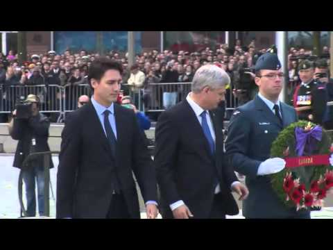 Stephen Harper and Justin Trudeau lay wreath together at National War Memorial