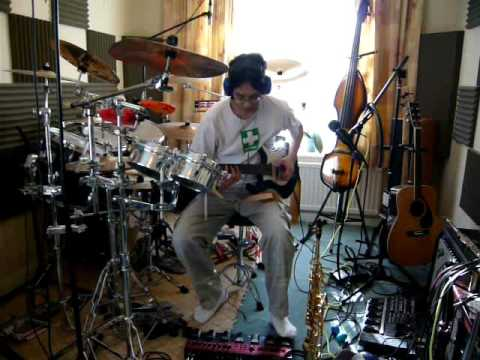 Multi-instrumental live loop pedal song by one man band
