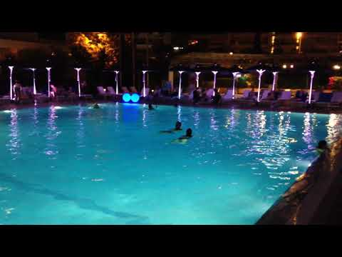 Night swimming by Athens Hilton