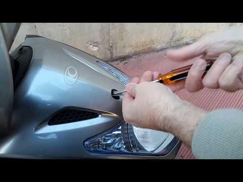 Kimco Agility 200i smontaggio scudo e sostituzione lampadina anabbagliante