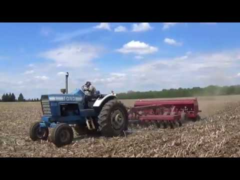 Ford 8600 tractor pulling a Case IH No Till drill in Michigan