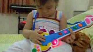 DanNhi playing guitar