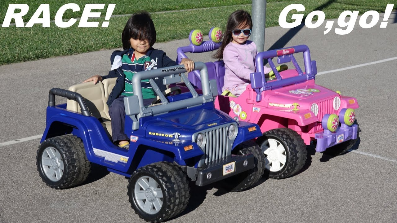 Ride-On Power Wheels Racing! Blue Jeep Wrangler VS Pink Barbie Jeep Wrangler