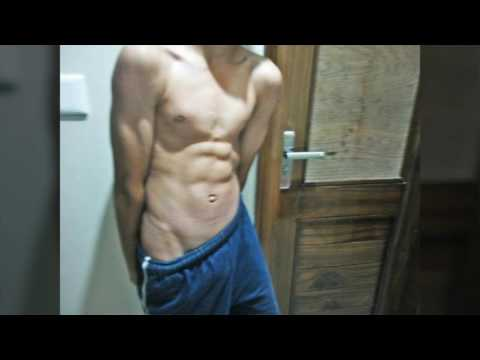 14 year old flexing ( abs , v line and biceps )