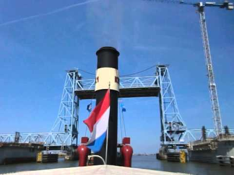 Steam Tug Hercules whistling under the Botlek bridge Rotterdam Holland